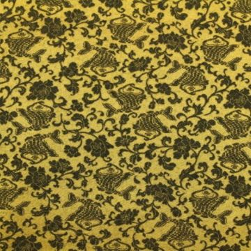 Stretch Jacquard stof in goud met zwarte print